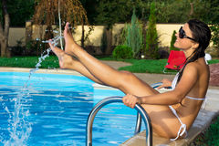 Beautiful girl at swimming pool. Outdoor Stock Images
