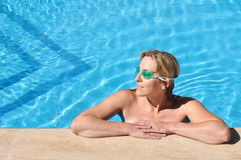 Beautiful girl in a swimming pool Royalty Free Stock Photo