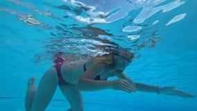 Beautiful girl in swimming pool. Beautiful girl enjoys water in swimming pool stock video footage