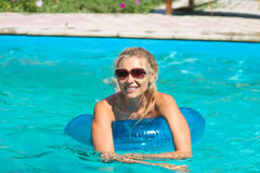 Beautiful girl in swimming pool. At a spa Stock Image