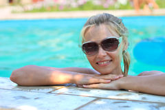 Beautiful girl in swimming pool. At a spa Royalty Free Stock Images