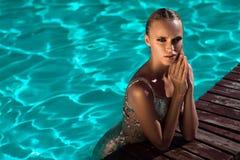 Beautiful girl swimming stock images