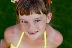 Young girl in a swimsuit on a shelf by the pool Royalty Free Stock Image