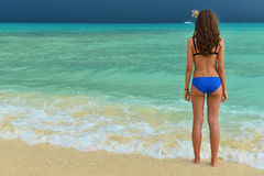 Beautiful girl in a swimsuit on the tropical sea. Woman with a b Royalty Free Stock Photos