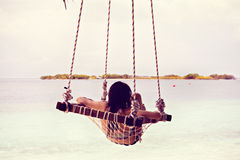 A beautiful girl in a swing Royalty Free Stock Image