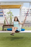 Beautiful girl on a swing on the park Royalty Free Stock Images