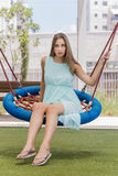 Beautiful girl on a swing on the park Royalty Free Stock Photo