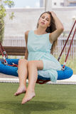 Beautiful girl on a swing on the park Stock Image
