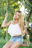 Beautiful girl on a swing Royalty Free Stock Image
