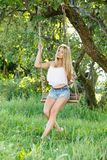 Beautiful girl on a swing Stock Images