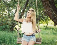 Beautiful girl on a swing Royalty Free Stock Photos