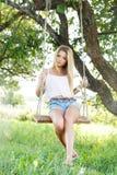 Beautiful girl on a swing Stock Photos