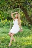 Beautiful girl on a swing Stock Image