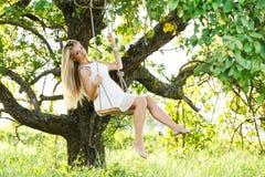 Beautiful girl on a swing Royalty Free Stock Photo