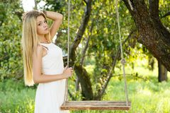 Beautiful girl on a swing Stock Photography