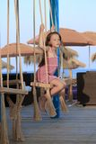 Beautiful girl swinging in a cradle Royalty Free Stock Photos