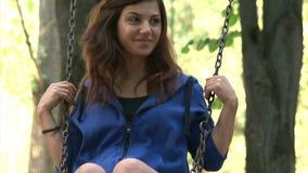 Beautiful girl swinging stock video footage