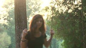 Beautiful girl swinging stock footage