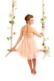 Beautiful girl swinging on white background Royalty Free Stock Image