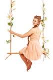 Beautiful girl swinging Royalty Free Stock Image