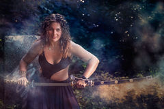 Beautiful girl with a sword Stock Photography