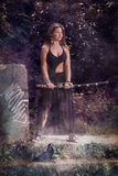 Beautiful girl with a sword Royalty Free Stock Photography