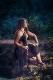 Beautiful girl with a sword stock photos