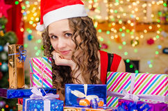 Beautiful girl at a table with Christmas gifts Royalty Free Stock Image