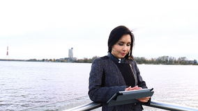 Beautiful girl with tablet stock footage