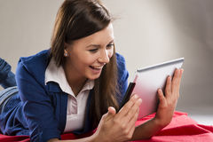 Girl with tablet Royalty Free Stock Photos