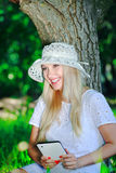 Beautiful girl with a Tablet PC Royalty Free Stock Photography