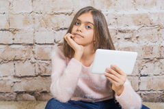 Beautiful girl with tablet. Royalty Free Stock Image