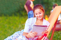Beautiful girl with tablet on summer picnic Royalty Free Stock Images