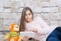 Beautiful girl with  tablet Royalty Free Stock Photos