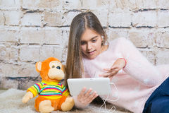 Beautiful girl with  tablet Royalty Free Stock Image
