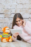 Beautiful girl with  tablet Royalty Free Stock Images