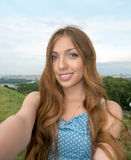 Beautiful girl taken picture of herself, selfie. Royalty Free Stock Photos