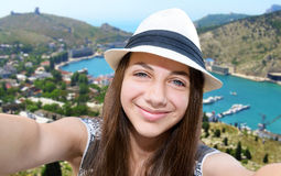 Beautiful girl taken pictures of her self. Stock Image