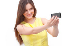 Beautiful girl taken taking selfie self-portrait with phone Royalty Free Stock Photos