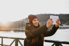 A beautiful girl takes a selfie or takes pictures of sights in Prague. stock images