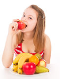Beautiful girl taking a bite of the apple Royalty Free Stock Photo