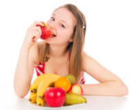Beautiful girl taking a bite of the apple Stock Photos