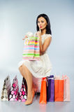 Beautiful girl taking out her present Royalty Free Stock Photo