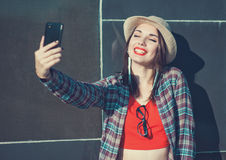 Beautiful girl taking picture of herself, selfie Royalty Free Stock Photos