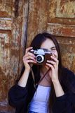 Beautiful girl taking picture with old camera Royalty Free Stock Photos