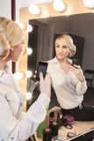 Beautiful girl taking selfie in the mirror Stock Images