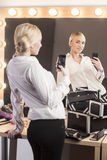 Beautiful girl taking selfie in the mirror Royalty Free Stock Photography