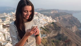 Beautiful girl taking a selfie. And sending it in a text message stock video footage