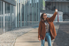 Beautiful girl taking a selfie in an urban context Royalty Free Stock Images