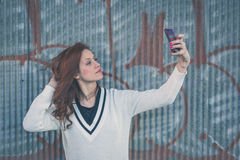 Beautiful girl taking a selfie in an urban context Stock Photography
